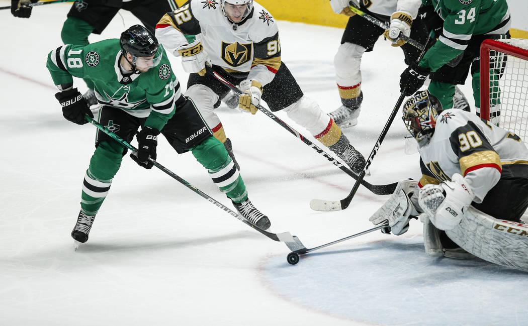 Dallas Stars forward Jason Dickinson (18) attempts a shot as Vegas Golden Knights goaltender Ma ...