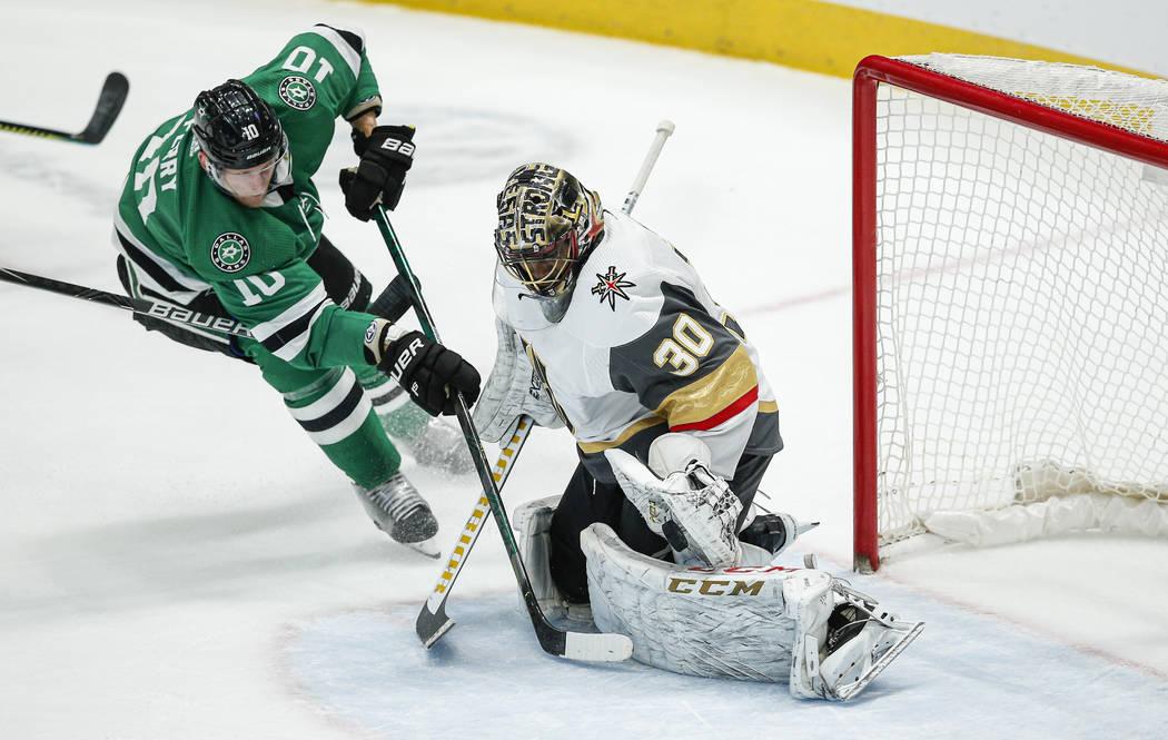 Dallas Stars forward Corey Perry (10) attempts a shot as Vegas Golden Knights goaltender Malcol ...