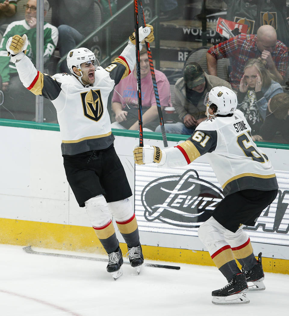 Vegas Golden Knights forward Max Pacioretty (67) is congratulated by forward Mark Stone (61) af ...
