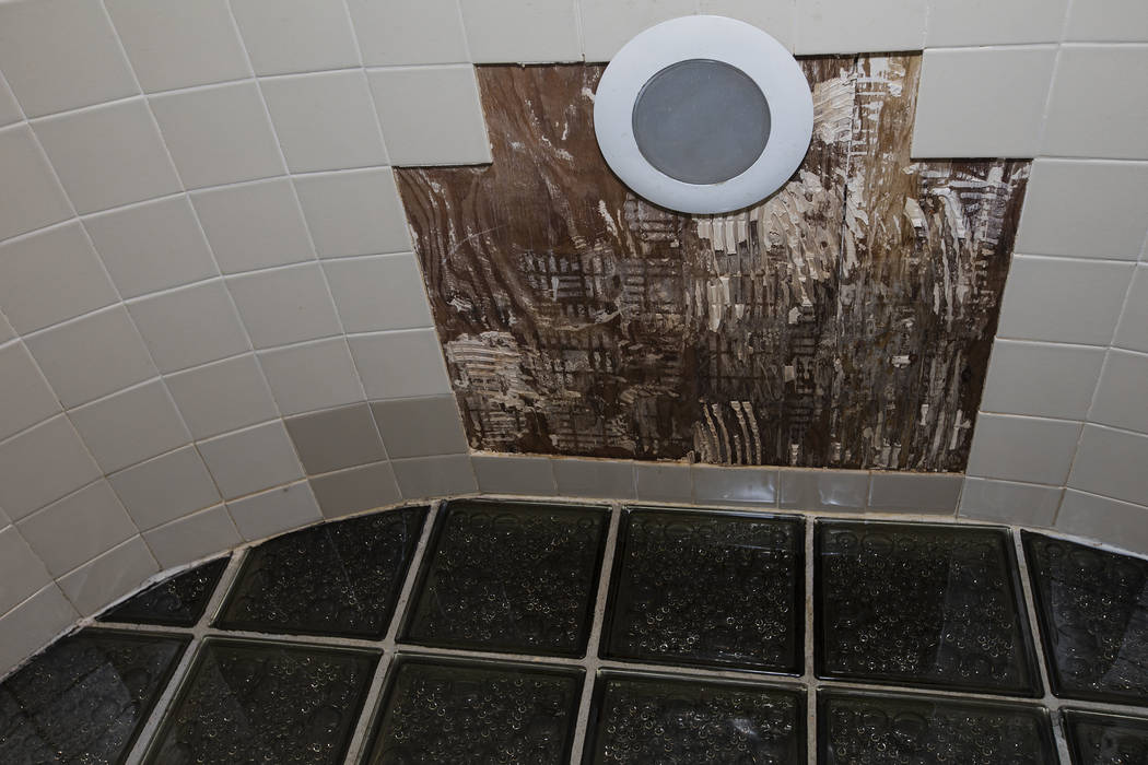 Tiles have fallen from the leaking ceiling in the guest bathroom of John and Mary Bodimer's ren ...