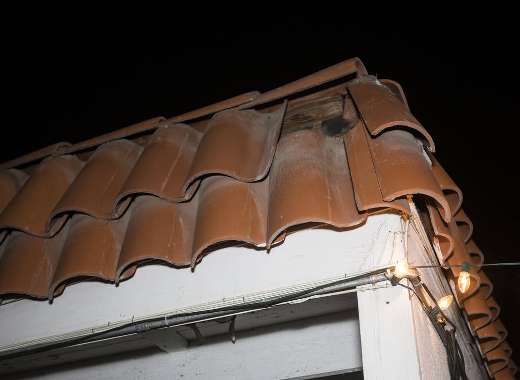 John and Mary Bodimer say tiles have fallen from the roof of their rental homein Las Vega ...