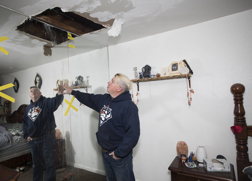 John Bodimer shows the Review-Journal where a leak in the roof of his Las Vegas rental home is ...