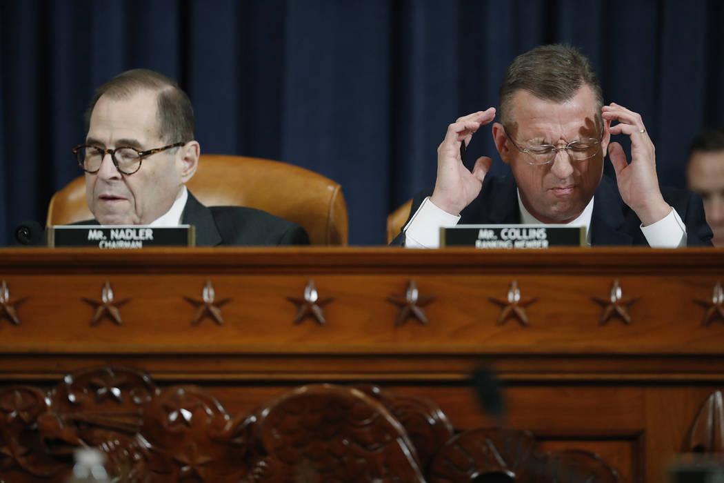 House Judiciary Committee ranking member Rep. Doug Collins, R-Ga., speaks next to House Judicia ...