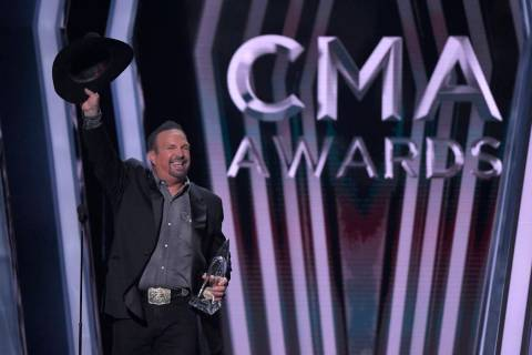 Garth Brooks accepts the award for entertainer of the year at the 53rd annual CMA Awards at Bri ...