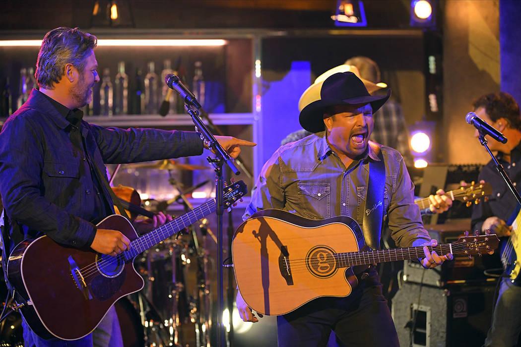 "Blake Shelton, left, and Garth Brooks perform ""Dive Bar"" at the 53rd annual CMA Awards at Bridg ..."