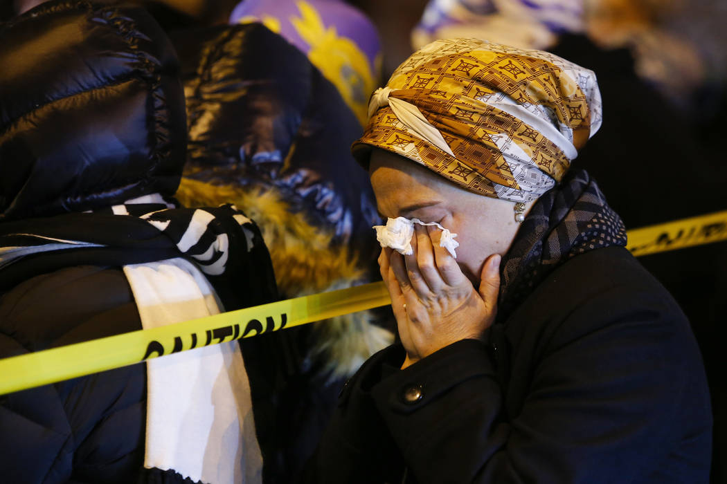 Orthodox Jewish women mourn during the funeral service of Mindel Ferencz who was killed in a ko ...