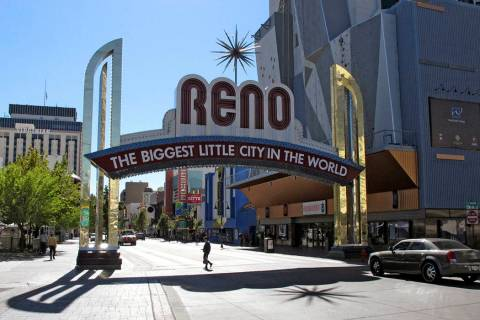 The famous Reno arch is seen on Virginia Street in downtown Reno. (AP Photo/Scott Sonner)