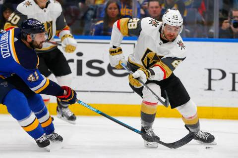 Vegas Golden Knights' William Carrier (28) loses control of the puck against St. Louis Blues' R ...