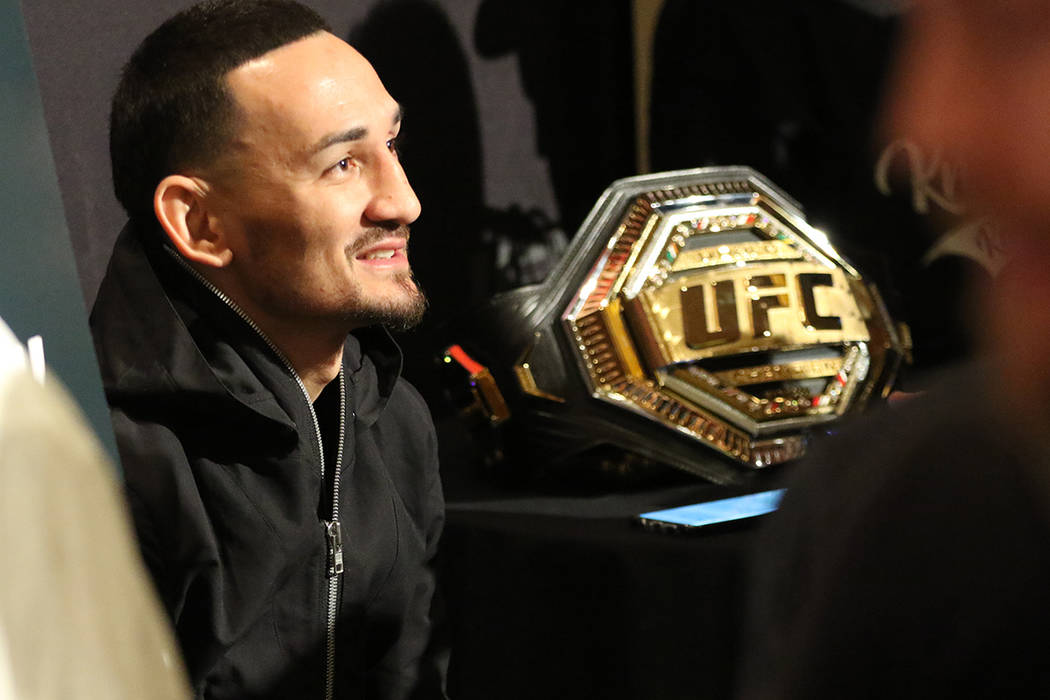 UFC featherweight champion Max Holloway takes questions during a UFC 245 media event at the Red ...