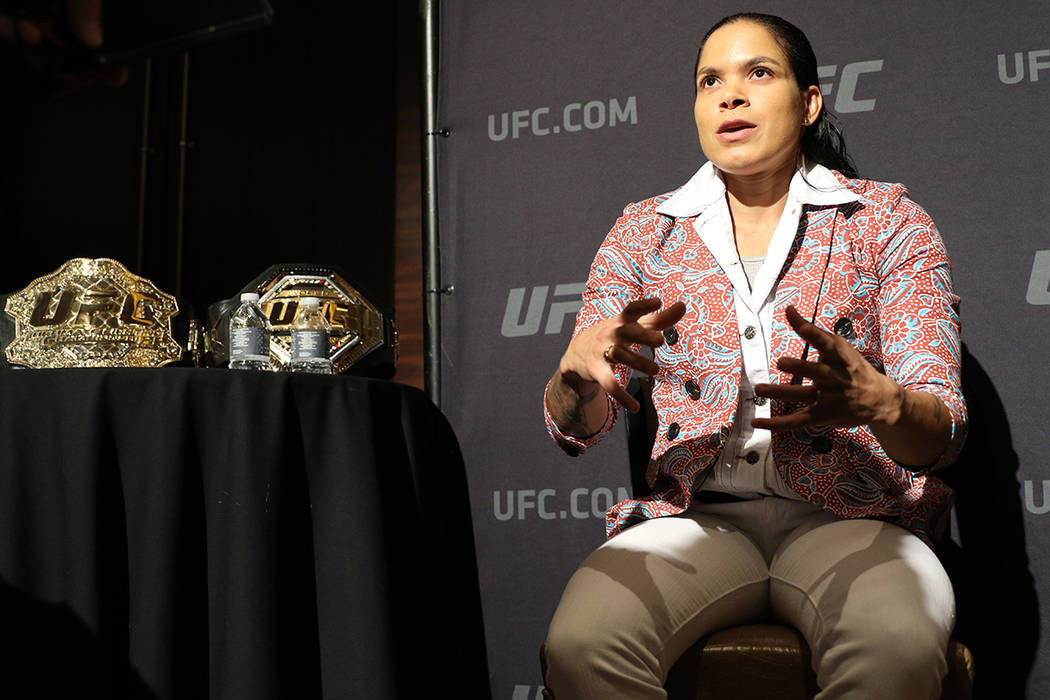 UFC women's featherweight and bantamweight champion Amanda Nunes speaks to reporters during a U ...