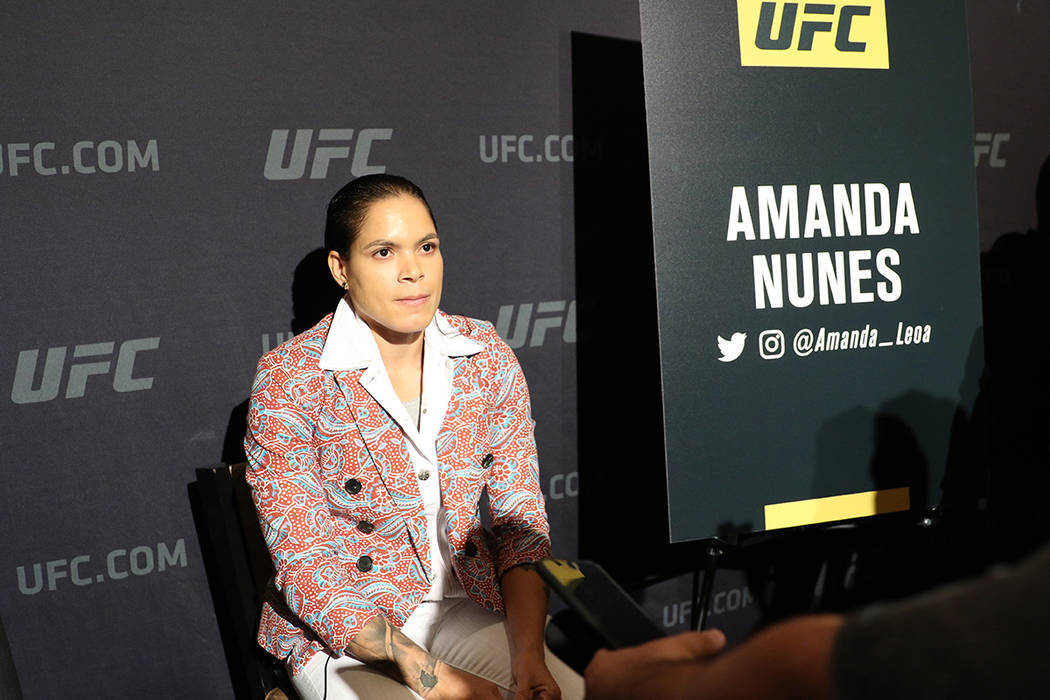 UFC women's featherweight and bantamweight champion Amanda Nunes takes questions from reporters ...