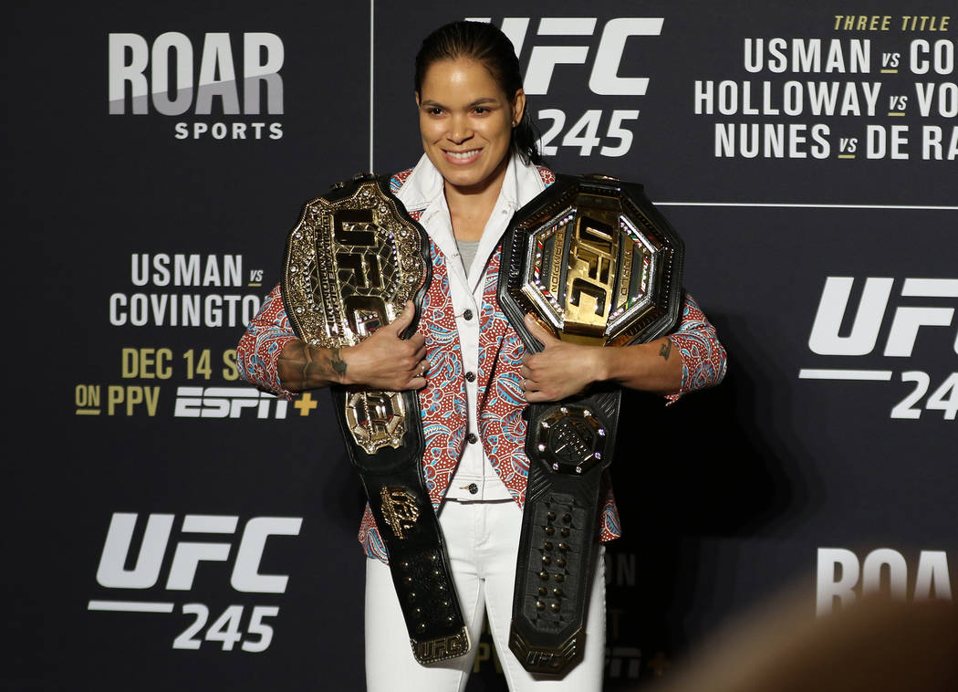 UFC women's two-division champion Amanda Nunes poses with her belts during a UFC 245 media even ...