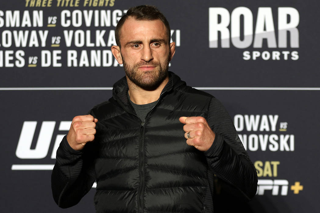 UFC featherweight Alexander Volkanovski poses for a photo during a UFC 245 media event at the R ...