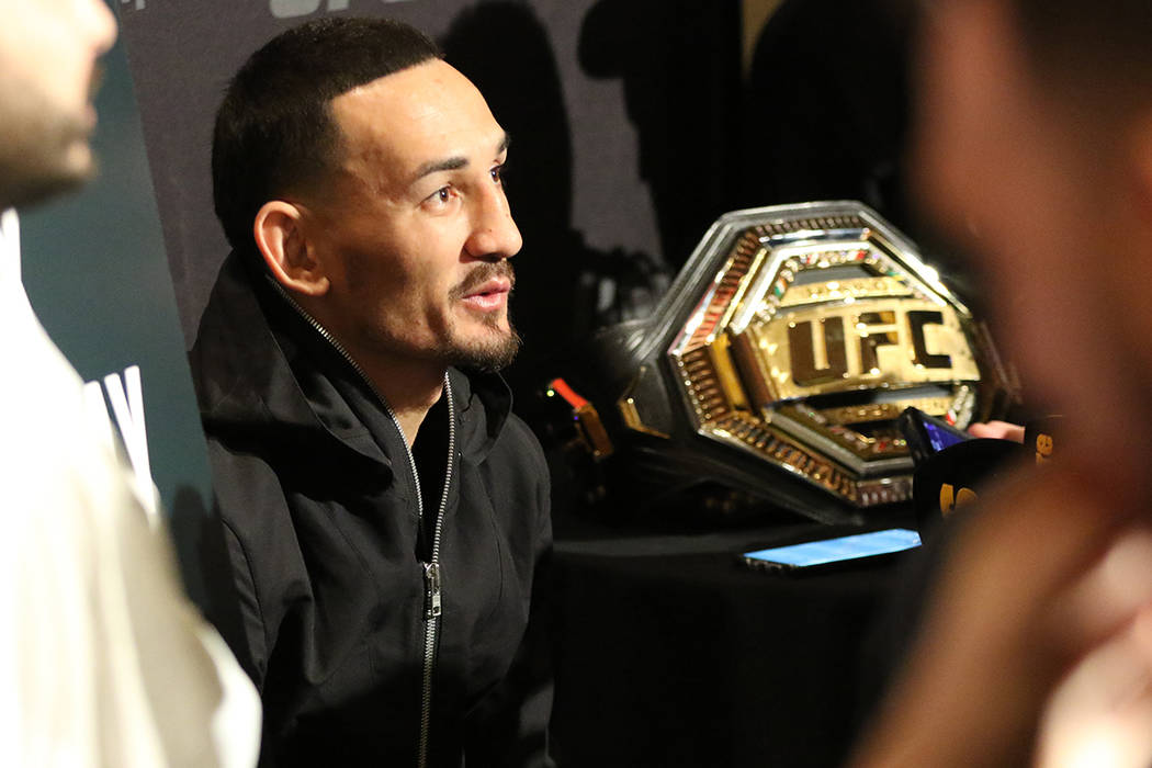 UFC featherweight champion Max Holloway answers questions from reporters during a UFC 245 media ...