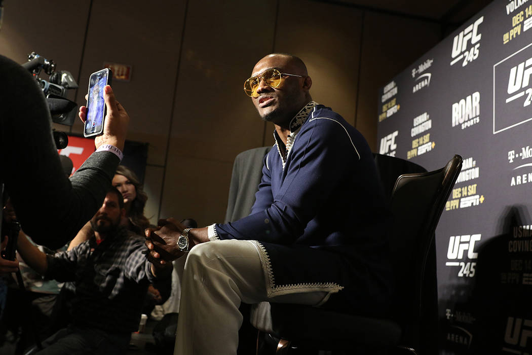 UFC middleweight champion Kamaru Usman speaks to reporters during a UFC 245 media event at the ...