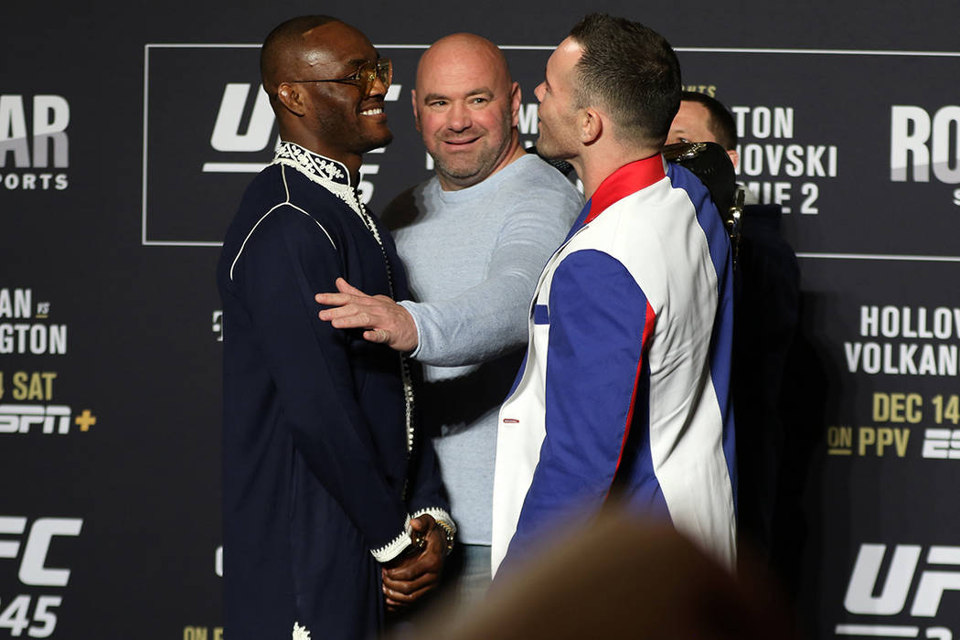 UFC welterweights Kamaru Usman and Colby Covington, right, engage in a face off as UFC presiden ...