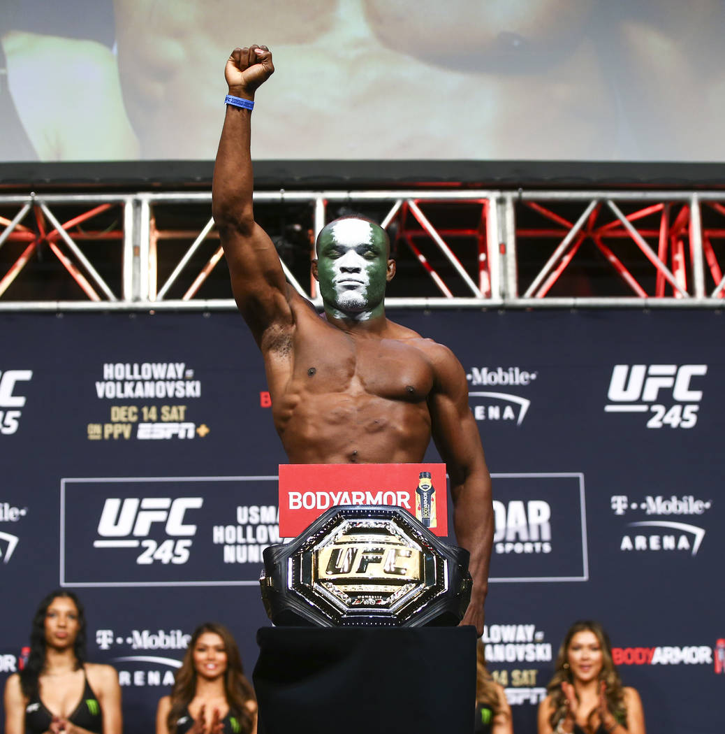 Kamaru Usman poses during the ceremonial weigh-in event ahead of his fight against Colby Coving ...