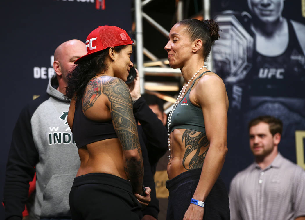 Amanda Nunes, left, and Germaine de Randamie face off during the ceremonial weigh-in event ahea ...