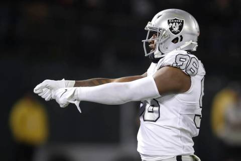 Oakland Raiders defensive end Clelin Ferrell (96) reacts after sacking Los Angeles Chargers qua ...