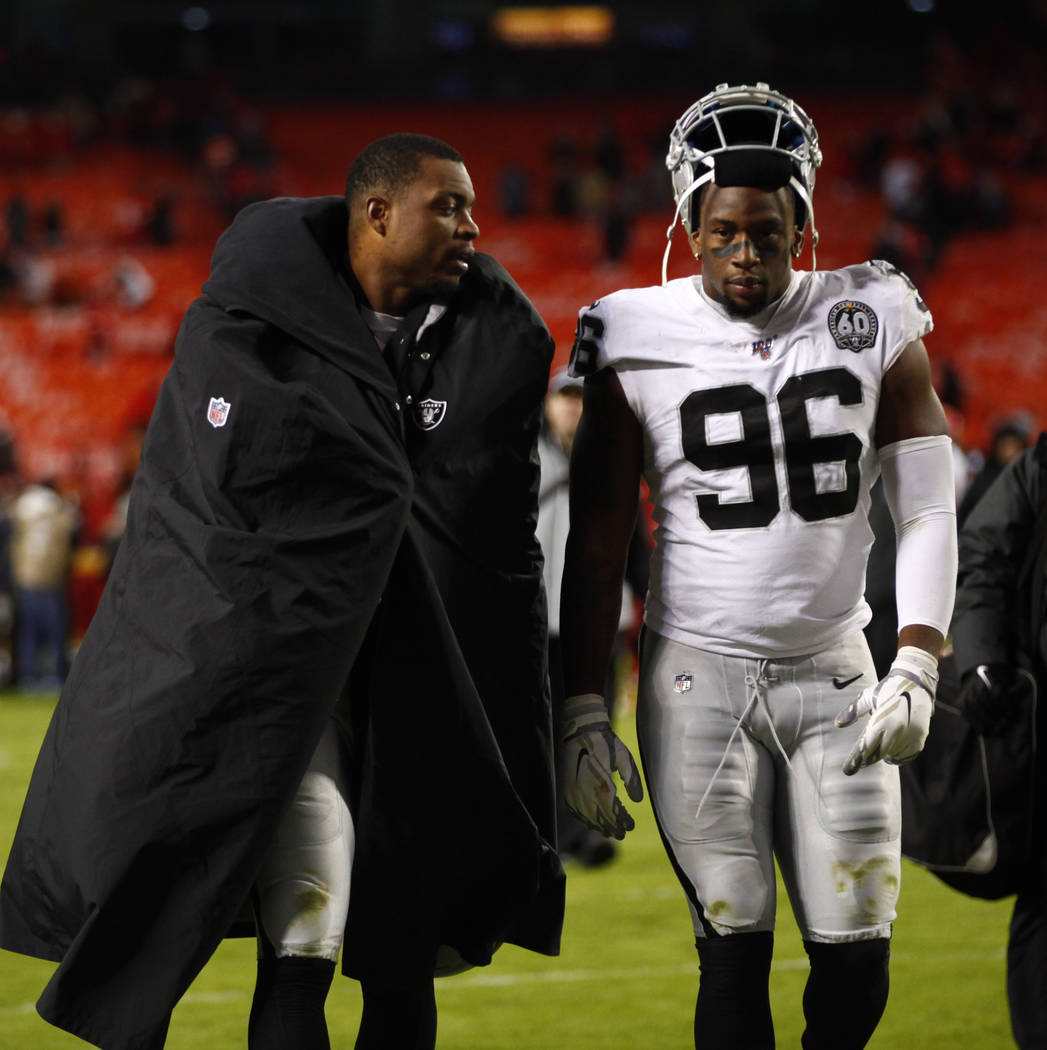 Oakland Raiders defensive end Dion Jordan (95) and defensive end Clelin Ferrell (96) walk off t ...