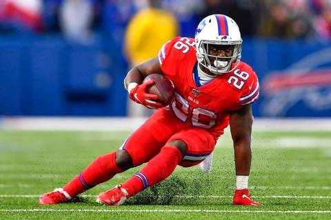 Buffalo Bills running back Devin Singletary (26) carries the ball during the second half of an ...