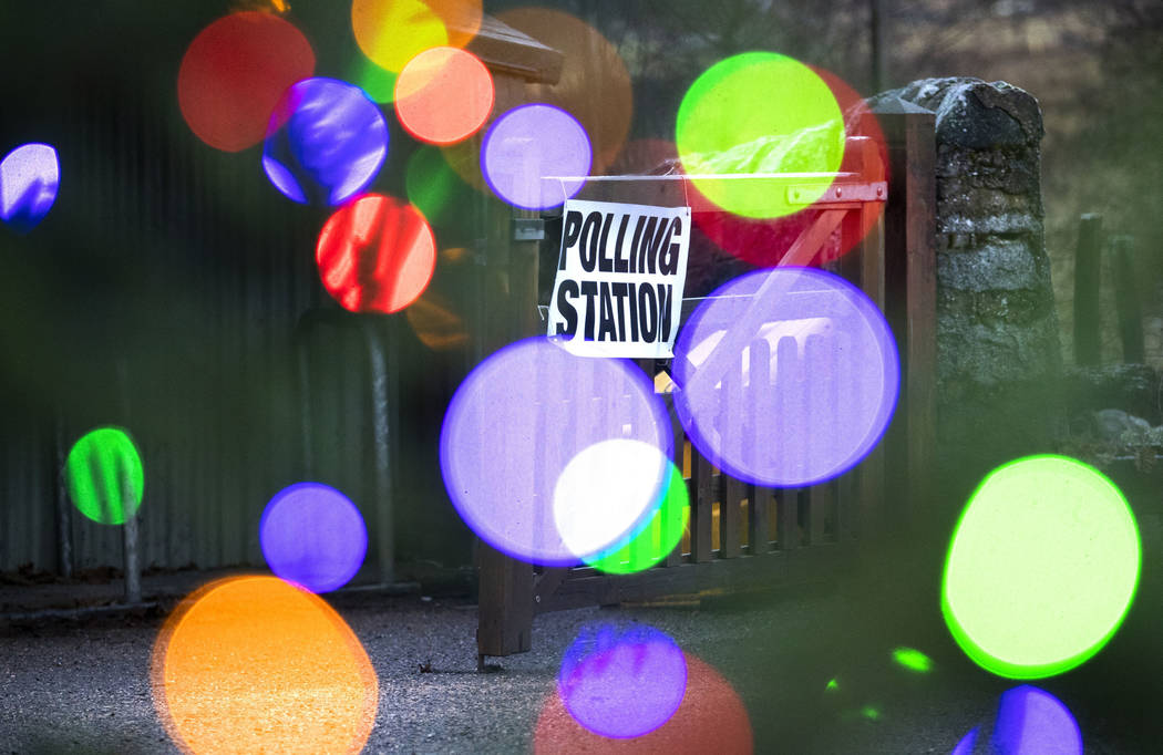 Lights on a Christmas tree next to a polling station in Laggan in the Cairngorms, Scotland, Thu ...