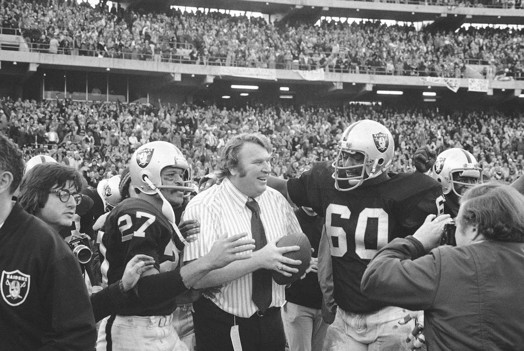 FILE - In this Dec. 21, 1974, file photo, Oakland Raiders coach John Madden holds the ball whic ...