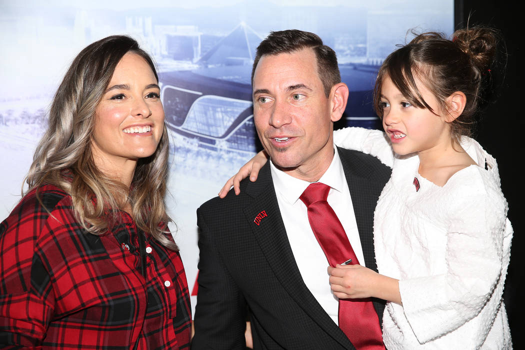 New UNLV football head coach Marcus Arroyo with his wife Kelly and daughter Cruz at UNLV's Fert ...