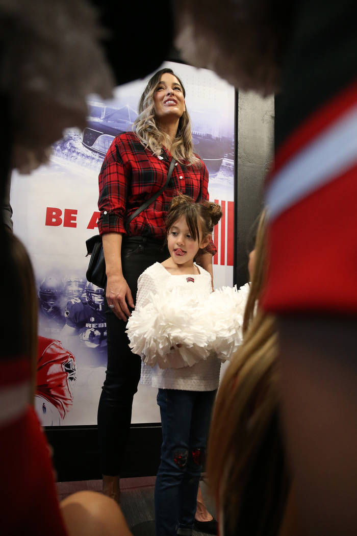 Kelly Arroyo and daughter Cruz, 6, the family of UNLV's new football coach Marcus Arroyo, atten ...