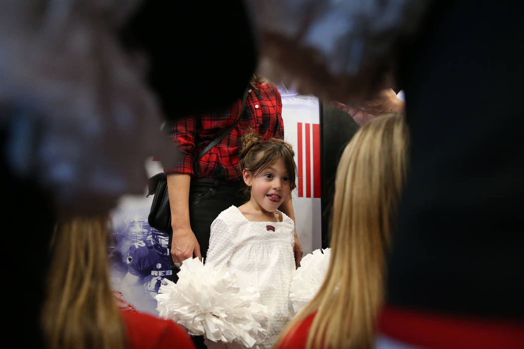 Cruz Arroyo, 6, the daughter of UNLV's new football coach Marcus Arroyo, attends a press confer ...