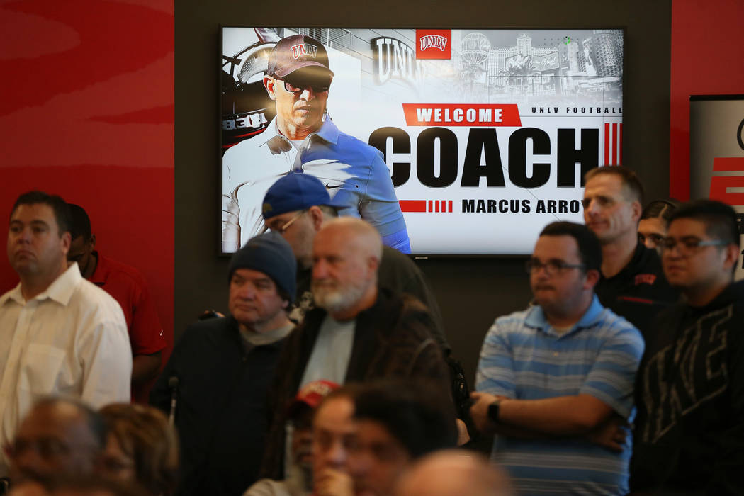 People attend a press conference to announce UNLV's new football head coach Marcus Arroyo, at U ...