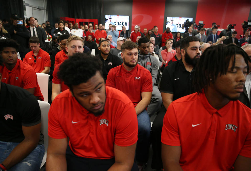 Student athletes attend a press conference to announce UNLV's new football head coach Marcus Ar ...