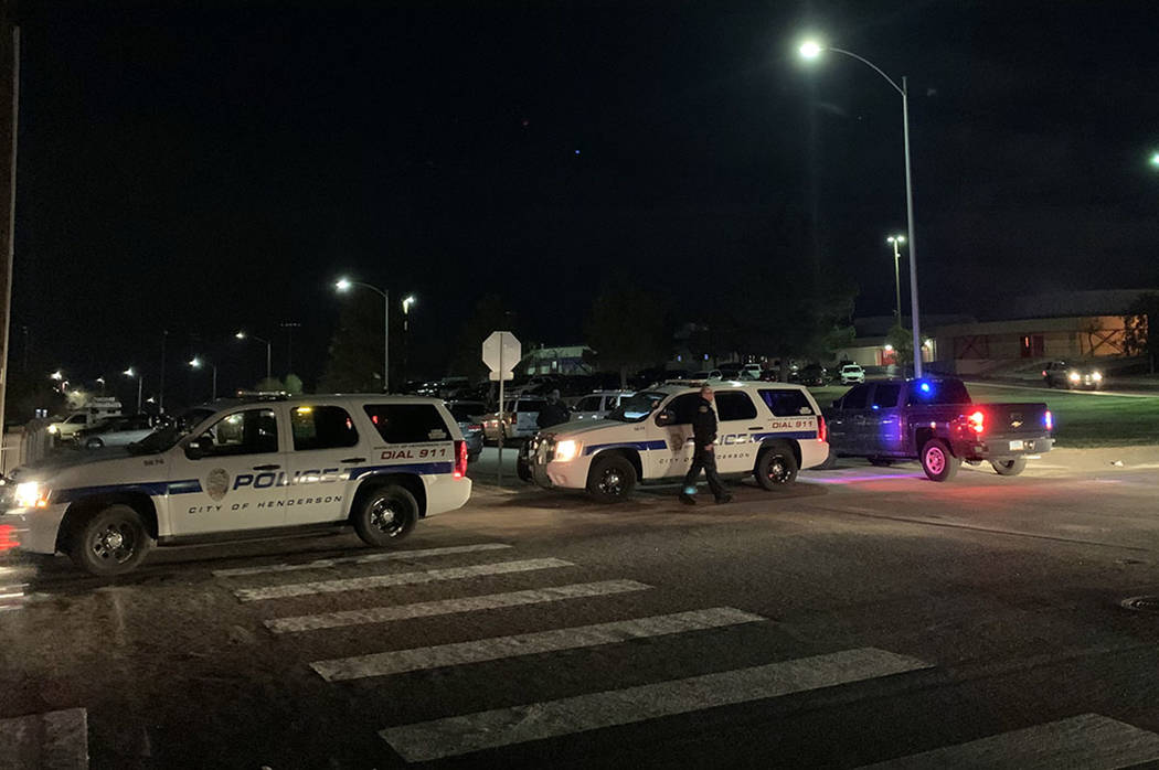 Henderson police investigate an officer-involved shooting in a residential area near Warm Sprin ...