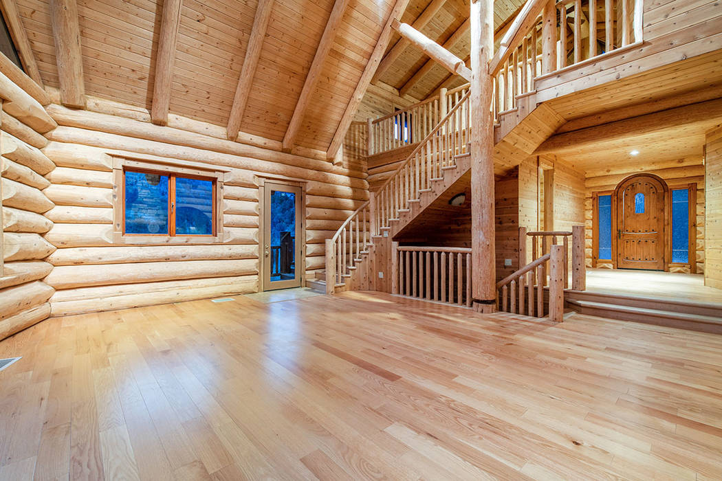 Berkshire Hathaway Home Services The owner purchased hand-hewn Douglas Fir logs from a craftsma ...