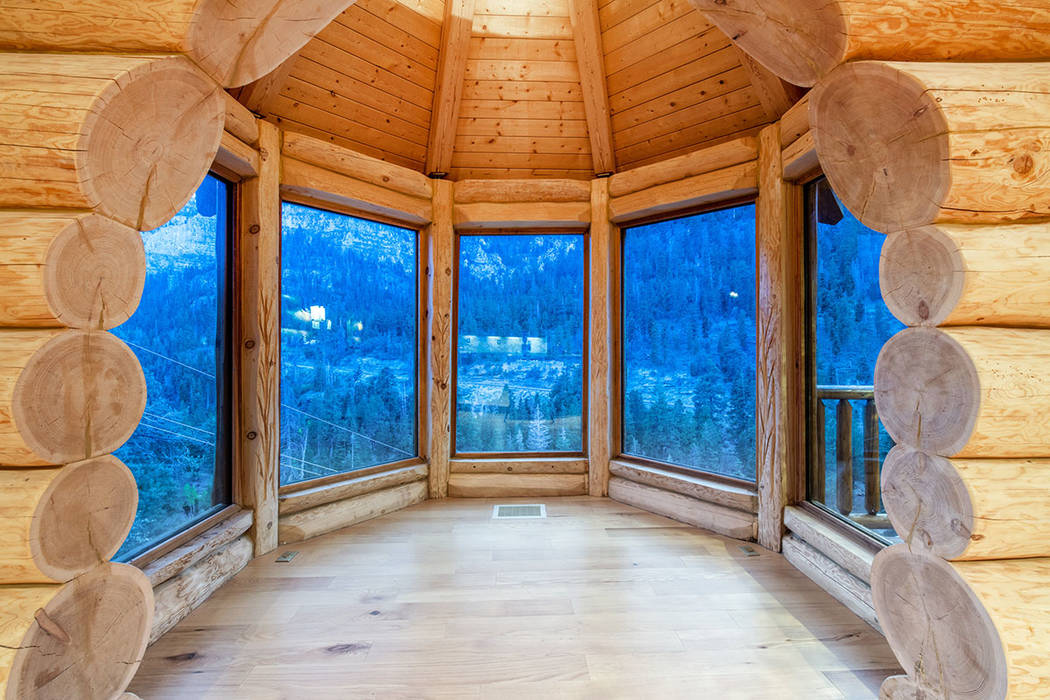 Berkshire Hathaway Home Services The views of the pine forest is the star of the home.