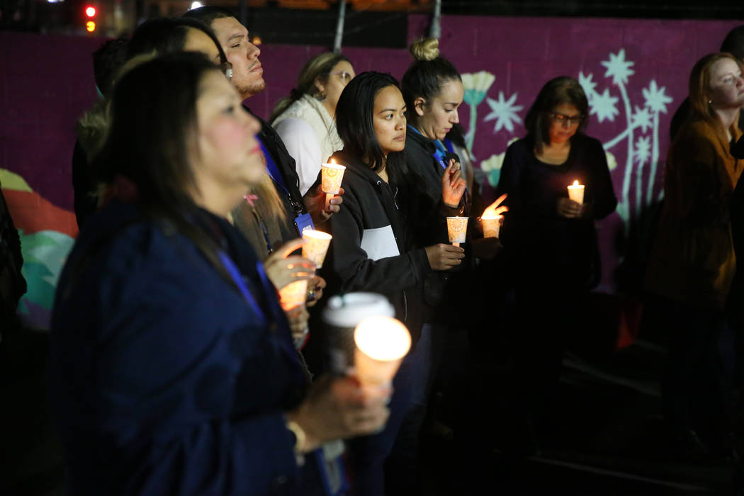 People attend a candlelight vigil to memorialize the homeless people of Las Vegas who died in t ...
