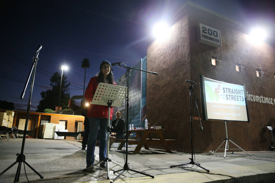 Merideth Spriggs, chief kindness officer for Caridad, speaks during a candlelight vigil to memo ...