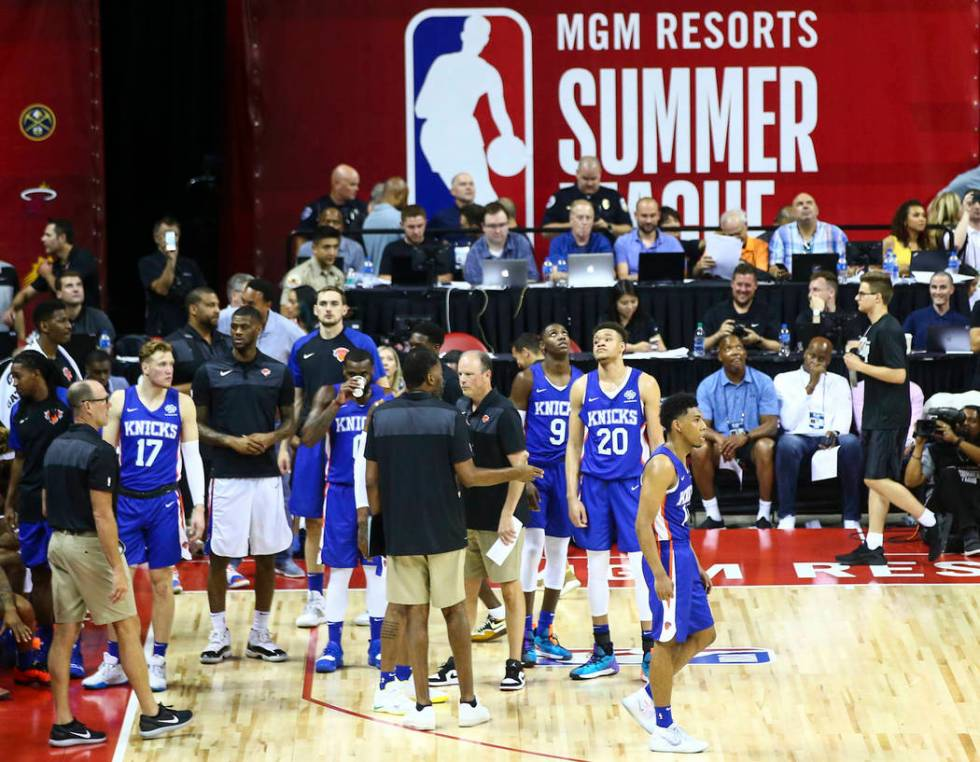 Members of the New York Knicks look on after an earthquake halted their basketball game against ...