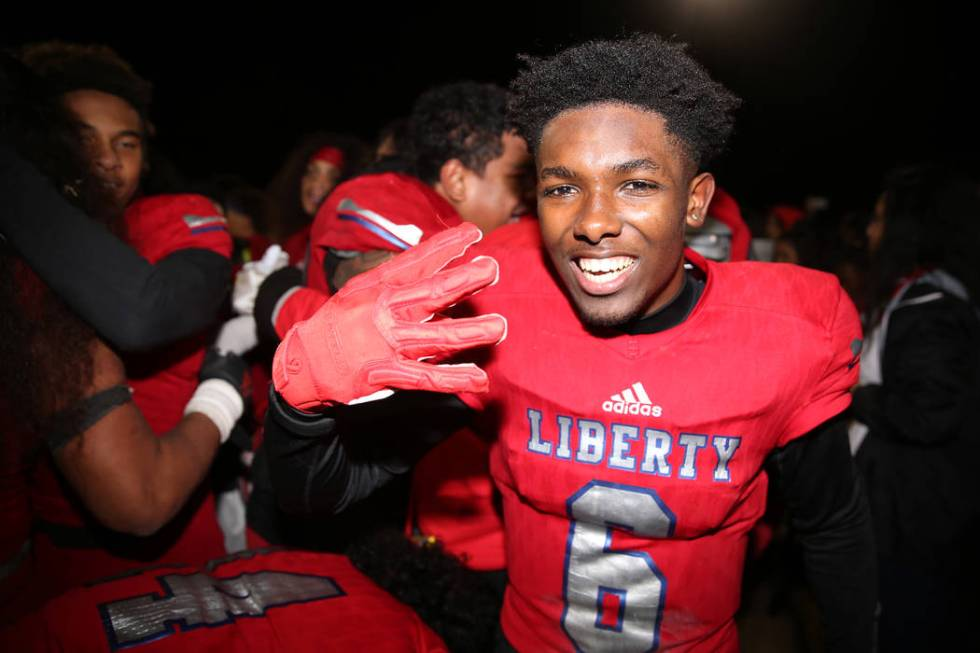 Liberty's Donte Bowers (6) celebrates his team's 30-24 overtime win against Bishop Gorman in th ...