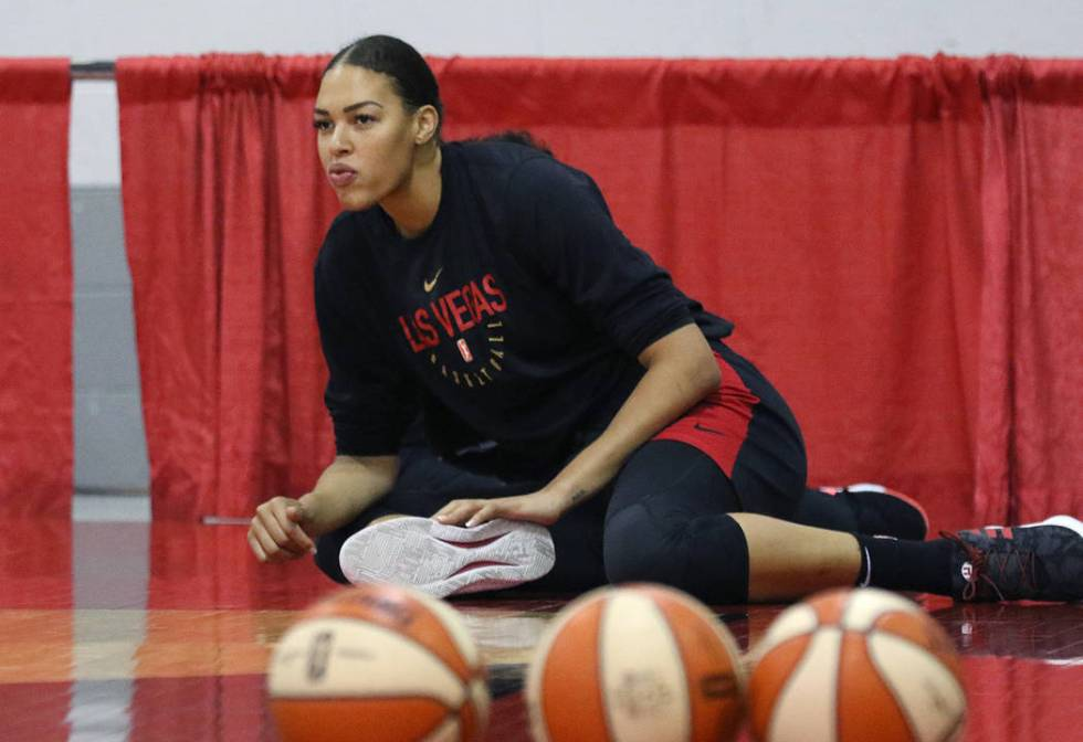 Las Vegas Aces' Liz Cambage stretches during team practice at Cox Pavillion on Friday, Aug. 30 ...