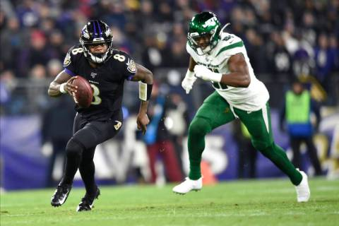 Baltimore Ravens quarterback Lamar Jackson (8) runs with the ball as New York Jets outside line ...