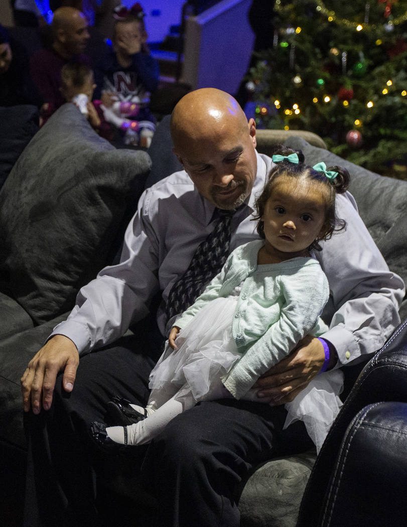 Chris Ritenour holds his daughter, Rayleigh Ritenour, 1, for the second time in her life at HOP ...