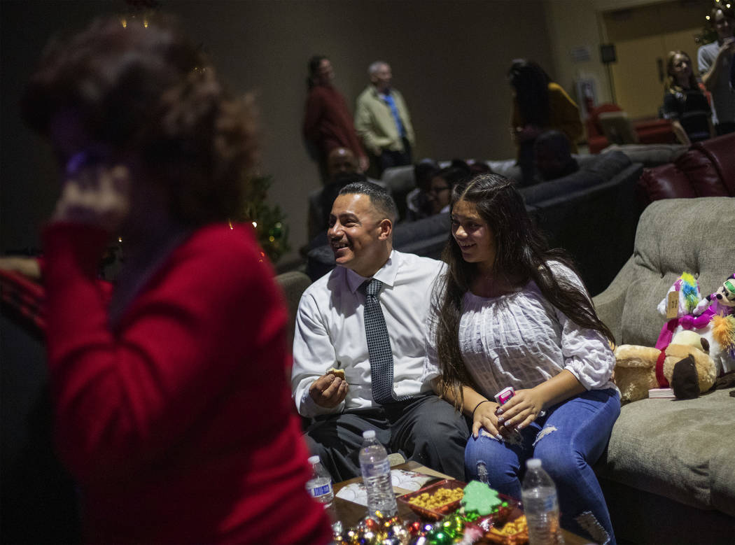 Jimmy Bocanegra, center, laughs with his daughter, Arianna Bocanegra, 11, right, as his mother ...