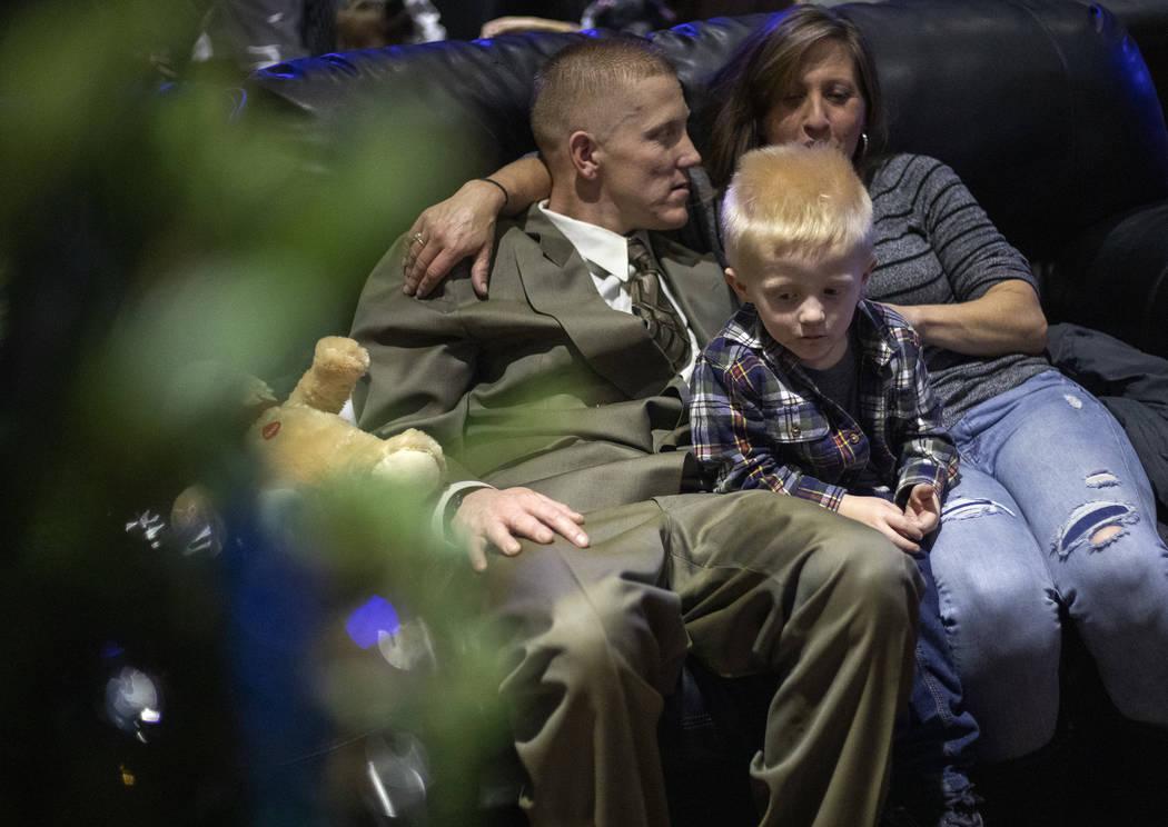 Raedyn Brackeen, 3, sits between his parents Robert Brackeen, left, and Carsen Brackeen, right, ...