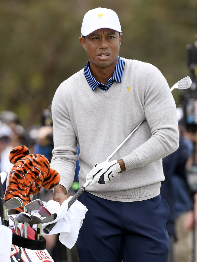 U.S. team player and captain Tiger Woods prepares to make shot on the 16th fairway in their fou ...