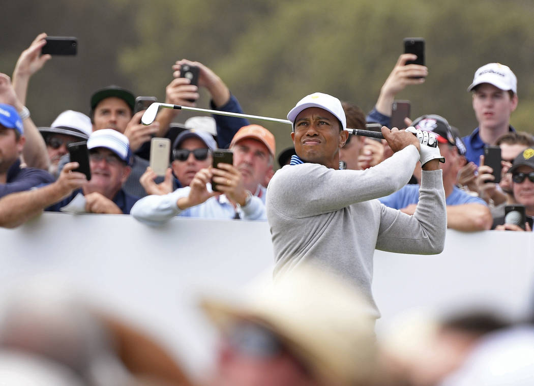 U.S. team player and captain Tiger Woods tees off on the 5th hole in their foursomes match duri ...