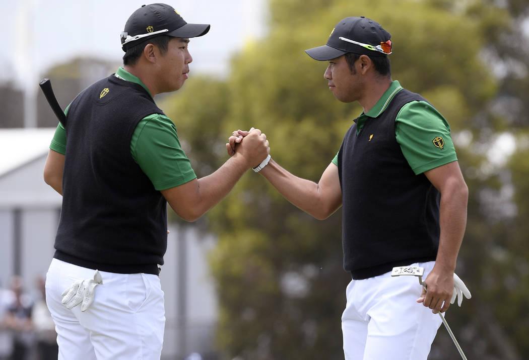 International team player Byeong Hun An, of South Korea, left, and playing partner Hideki Matsu ...