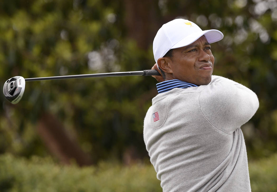 U.S. team player and captain Tiger Woods tees off on the 9th hole in their foursomes match duri ...