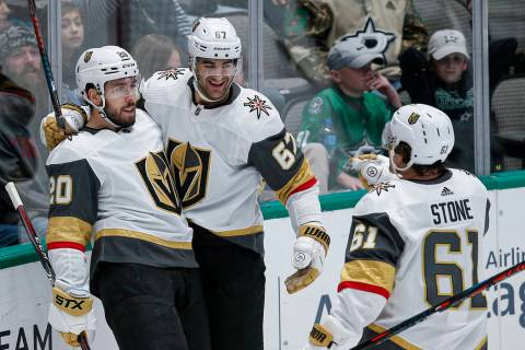 Vegas Golden Knights forward Chandler Stephenson (20) is congratulated by teammates after scori ...