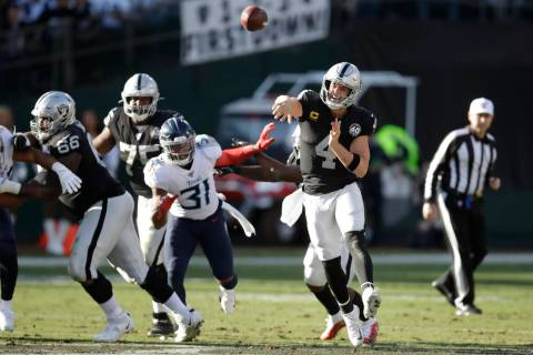 Oakland Raiders quarterback Derek Carr (4) passes against the Tennessee Titans during the first ...